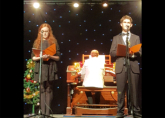 Charlotte and Robert singing in the RWA Christmas Concert accompanied by Michael Wooldridge - December 2016